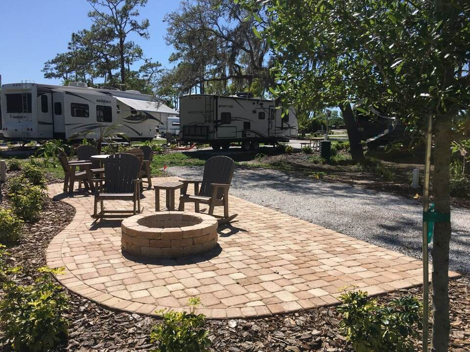 Inviting Rv Patio Site Design At The Clearwater Lake Tarpon Koa Clearwater Lake Florida Campgrounds Koa Campgrounds