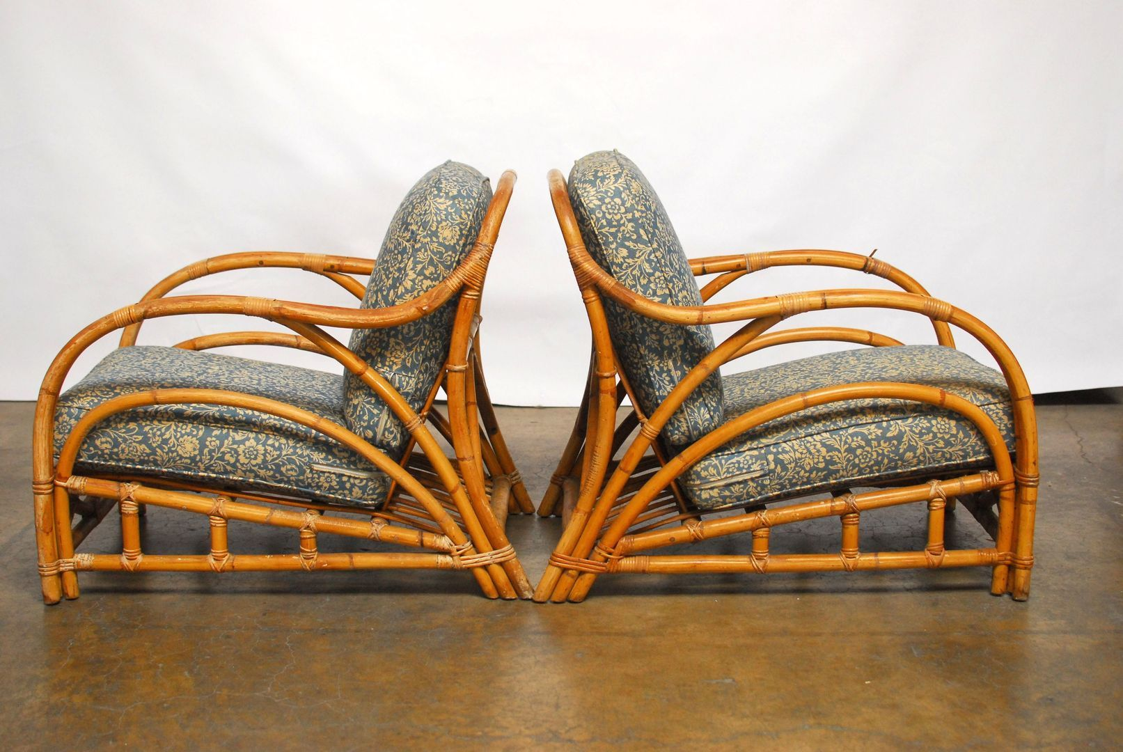 Pair of chic art deco style bamboo lounge chair featuring a low