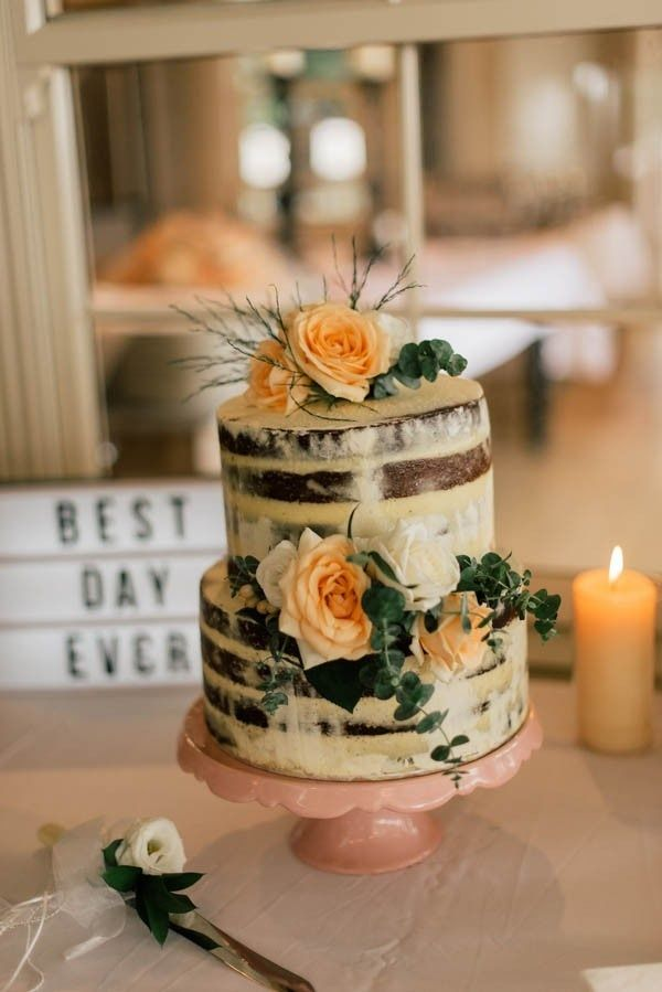 Bohemian nearly naked cake with peach floral decorations styled wedding cake junglespirit Images