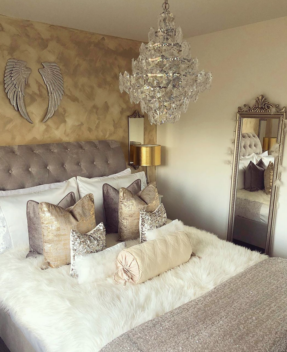 sleigh bed in a gold and silver bedroom
