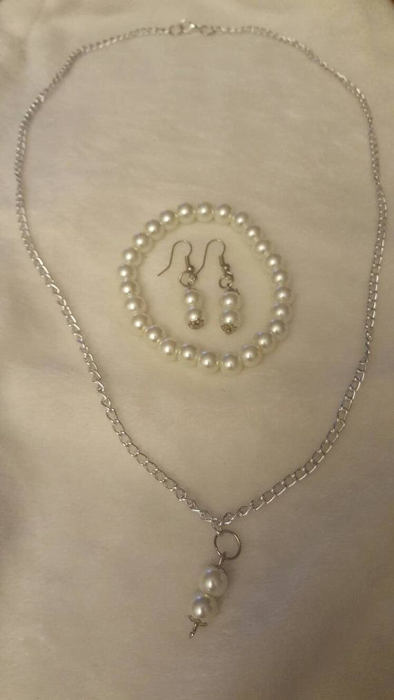 Check out this item in my Etsy shop https://www.etsy.com/listing/471144730/white-bead-necklace-set