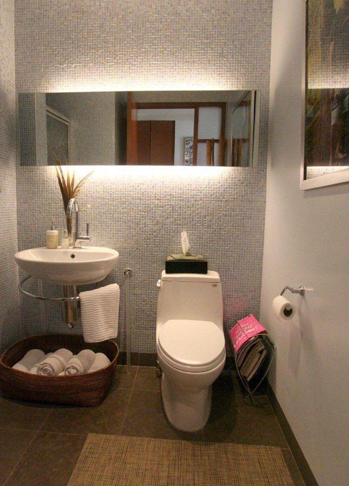 Lavabo com decoração em cesto para apoio de toalhas Cosas de baño