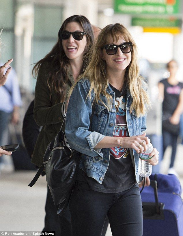 b8ff7f0101fb All smiles on board  The smiley pair Liv Tyler and Dakota Johnson grinned  as they stepped off the plane and landed at JFK