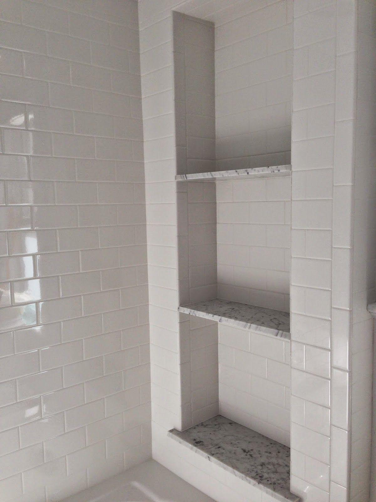 Marcie Reid Designs | shower shelves | white subway tile and carrera ...