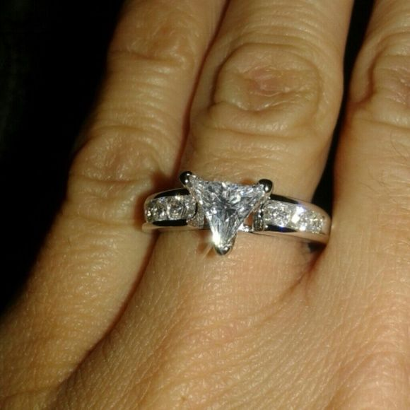Gorgeous! Trillion cut ring Size 6 NWT Gorgeous! (Triangle ) Trillion cut ,White topaz (about a carat)  and side accents Super brilliant and sparkly Pics do it no justice!   925 sterling silver stamped Jewelry Rings