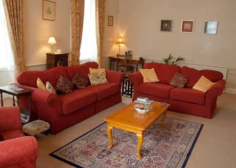 Living Room Furnishings And Design New Red Furniture With Creamy Walls And Carpet And Some Yellow And Inspiration