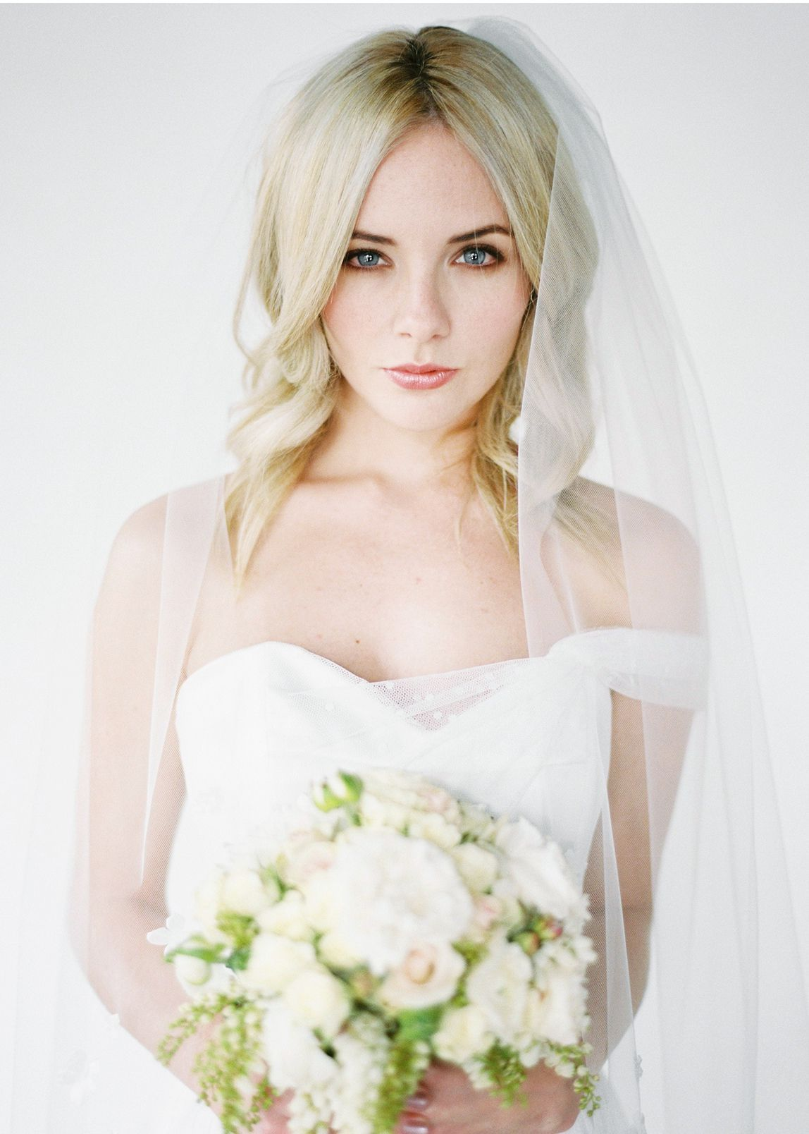 One of the most flattering veil lengths available the holly one of the most flattering veil lengths available the holly fingertip bridal veil complements a junglespirit Image collections