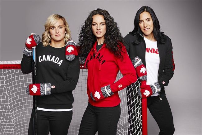 """the Canadian women's hockey team revealed the new Hudson bay Olympic mittens. the """"red mitten"""" campaign has raised over 28$ million for Canadian Olympic athletes over the past 7 years. these mittens have become a major trend because the are perfect way for Canadians to show their pride for their country and support their athletes. Taylor Beach"""