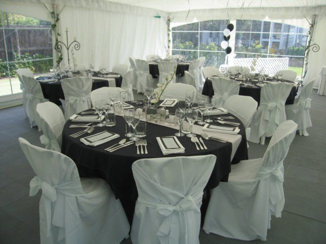 Formal dinner setting done in black or navy silver for Silver centerpieces for dining table