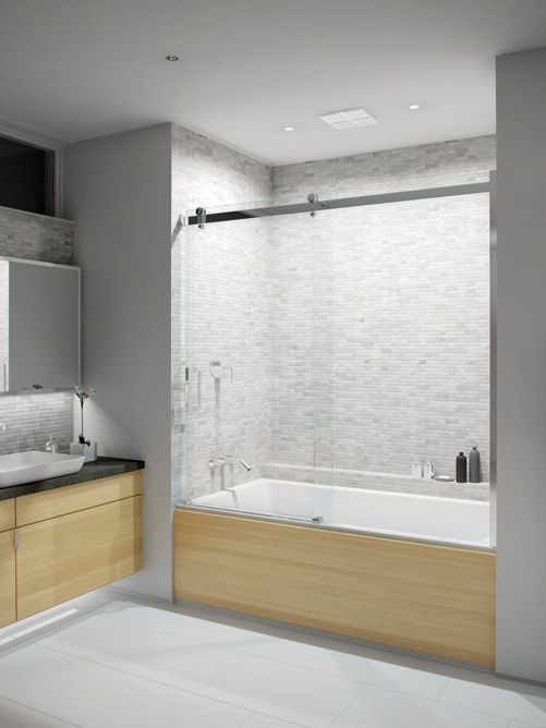 Bathtub shower doors with sliding glass to show off the beautiful tile and  make it seemglass bathtub doors frameless   Frameless Tub Enclosure next to a  . Tub Shower Combo Glass Doors. Home Design Ideas