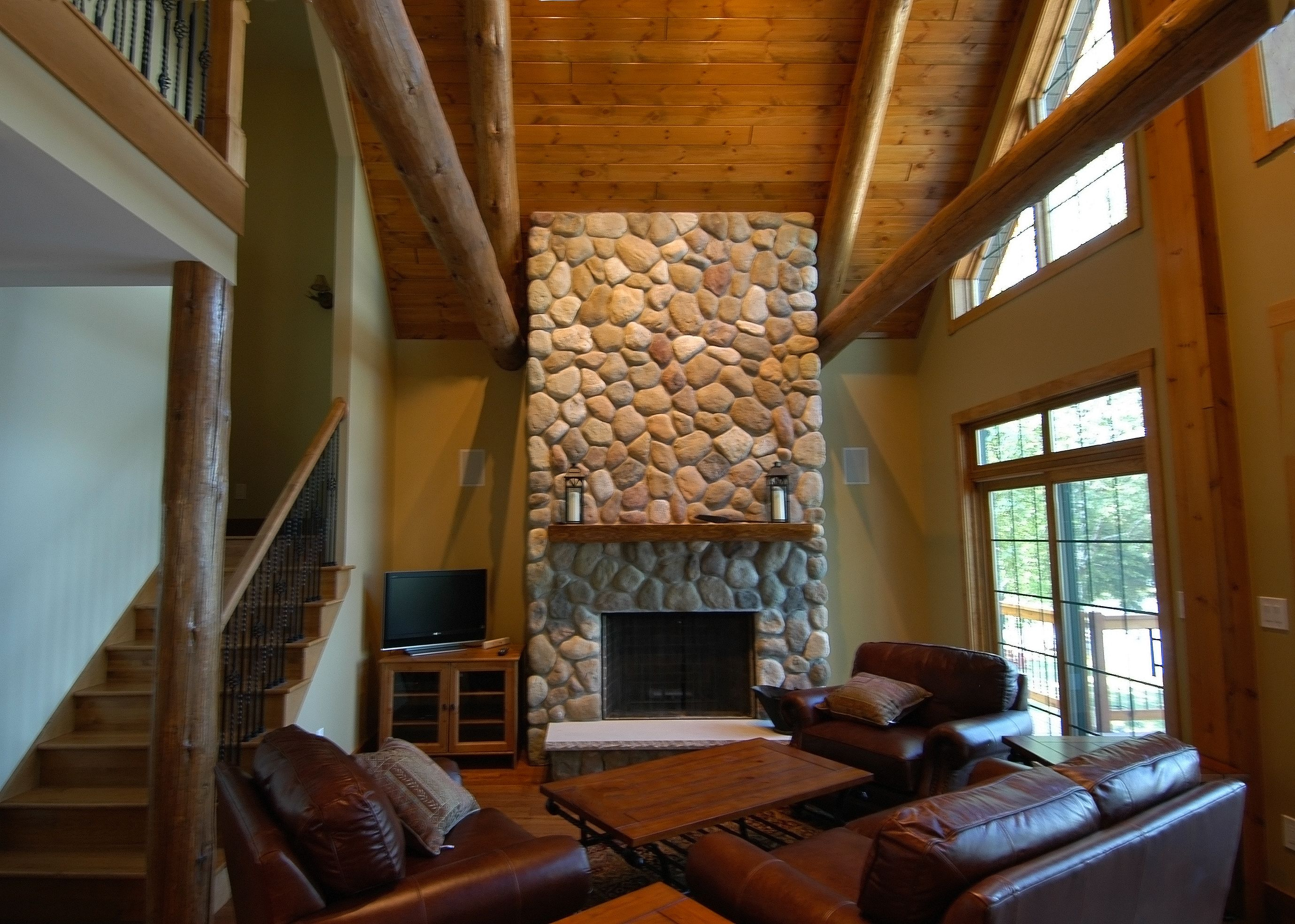 stone wood burning fireplace in this rustic cottage fireplaces by