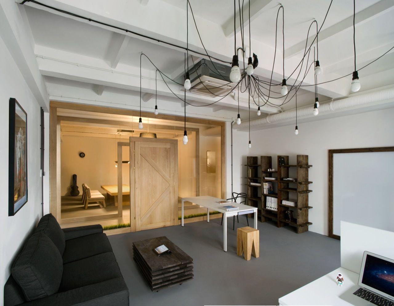 Office interior - pendant lights, shelving, table.