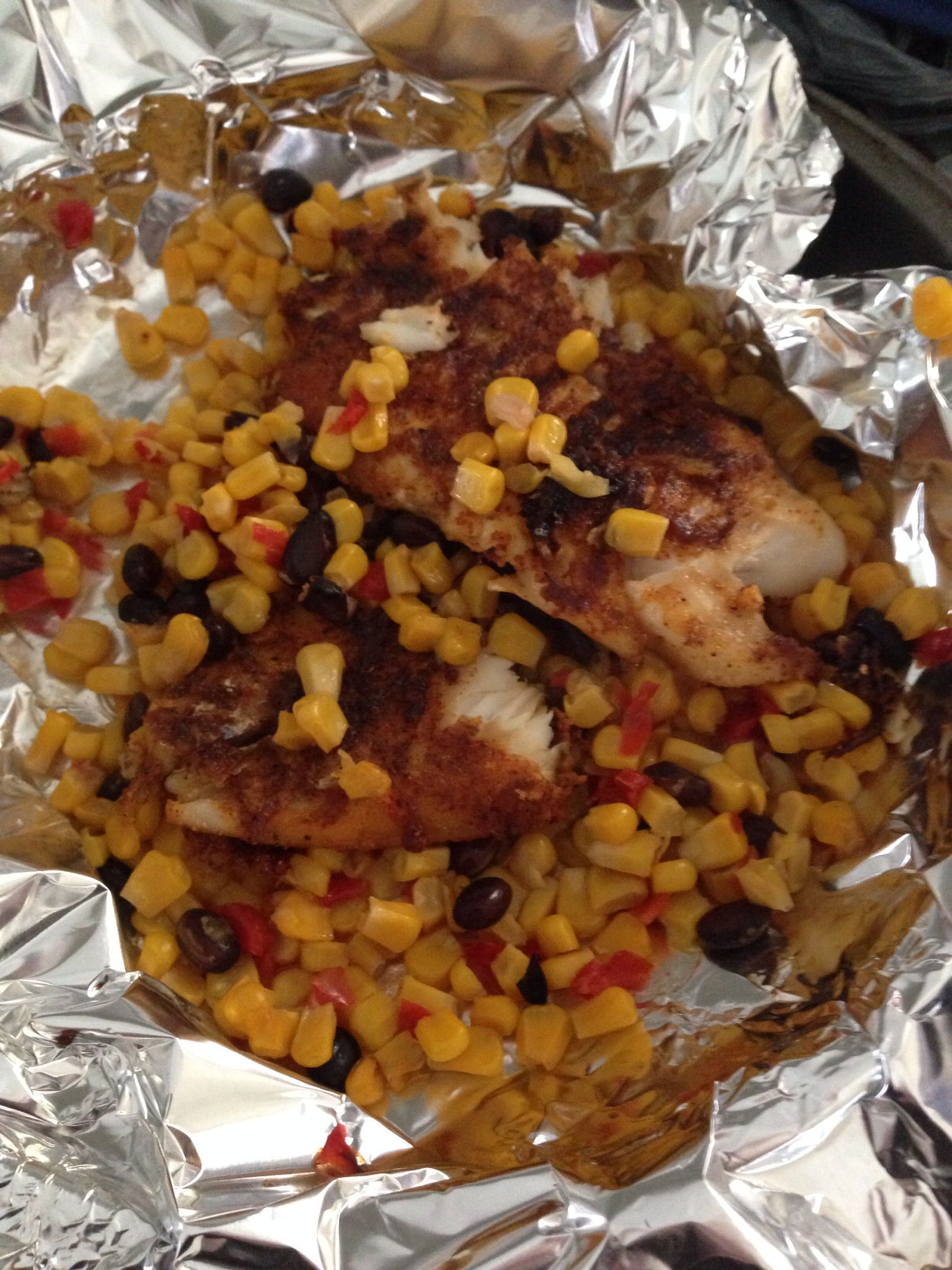 Chili lime Tilapia over a bed of roasted veggies
