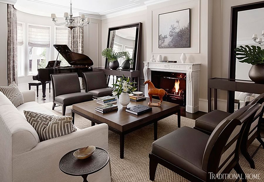 A Floating Arrangement Of Matching Leather Chairs And Long Sofa In The Living Room Allows