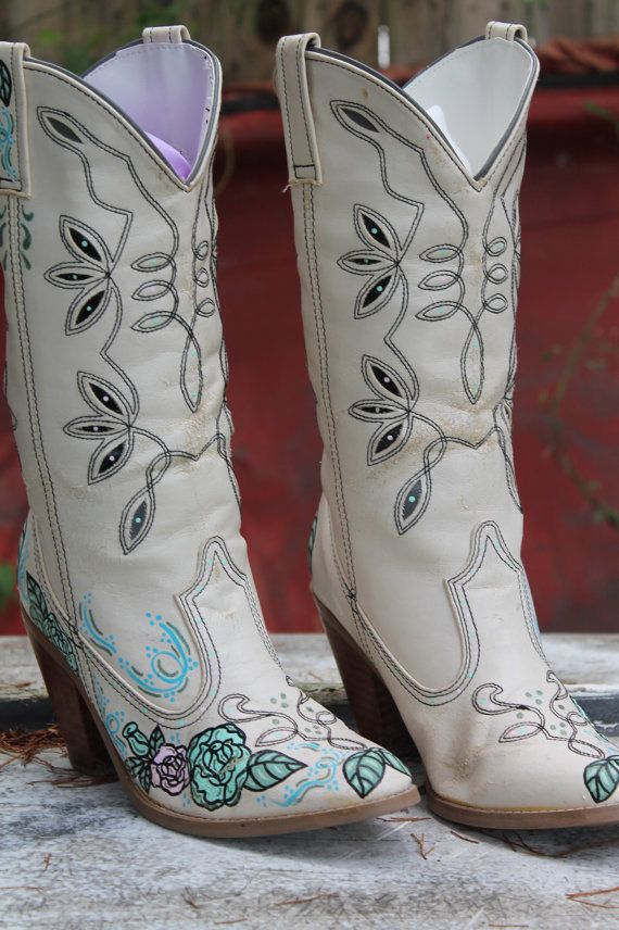 These are some amazing vintage NON-LEATHER cowboy boots, hand painted with roses and vines in vintage pale pink and pale aqua. The boots are white, man-made materials with a perfectly-worn in look to them. They are a little more shabby and chippy on the finish and the paint than the ones I usually would paint, but they look so romantic and worn in.... And they are perfect for a shabby wedding or barn dance.    Brand: Either:The Shoe Place-Sears  Size: 8M  Dimensions:  Sole- length: 11…