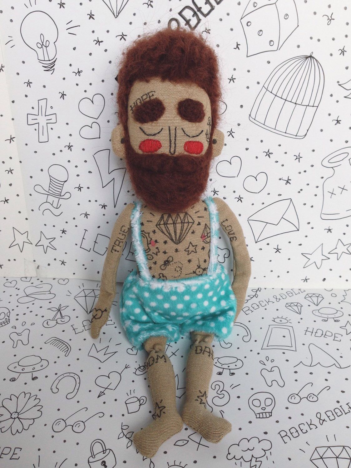 A personal favourite from my Etsy shop https://www.etsy.com/listing/251969884/cloth-collectible-hand-painted-hipster