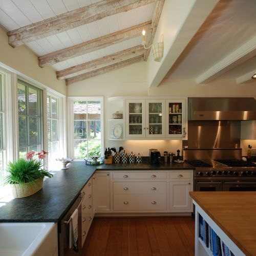 Colonial Kitchen And Great Room Addition: Kitchen Addition With White Rafters And Lots Of Windows In