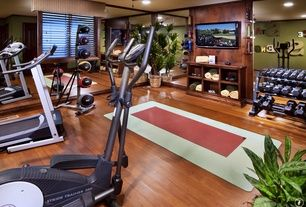 traditional home gym with hardwood floors crown molding