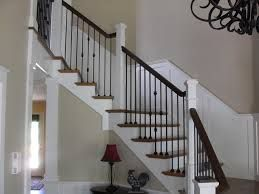 white newels w/ iron balusters | Wrought iron stair ...