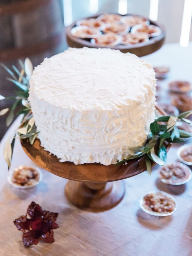 Vanilla frosted olive twig wrapped cake: http://www.stylemepretty.com/little-black-book-blog/2017/01/27/rustic-romantic-georgia-winter-wedding/ Photography: Simply Sarah - http://simplysarah.me/