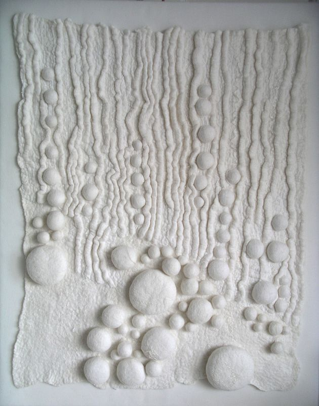 Felted fabric with white textures made using shibori tying & stitch techniques; fabric ...