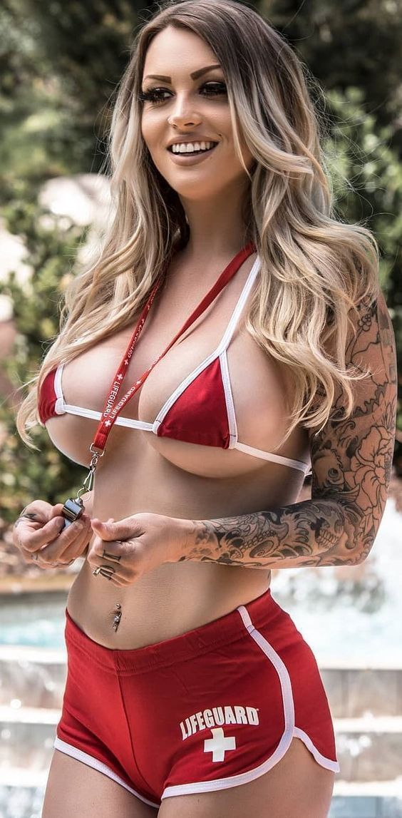 2eb3d608642c7 Gorgeous blonde beauty with huge breasts in a tight cleavage revealing red  sexy bikini. Bikini Top