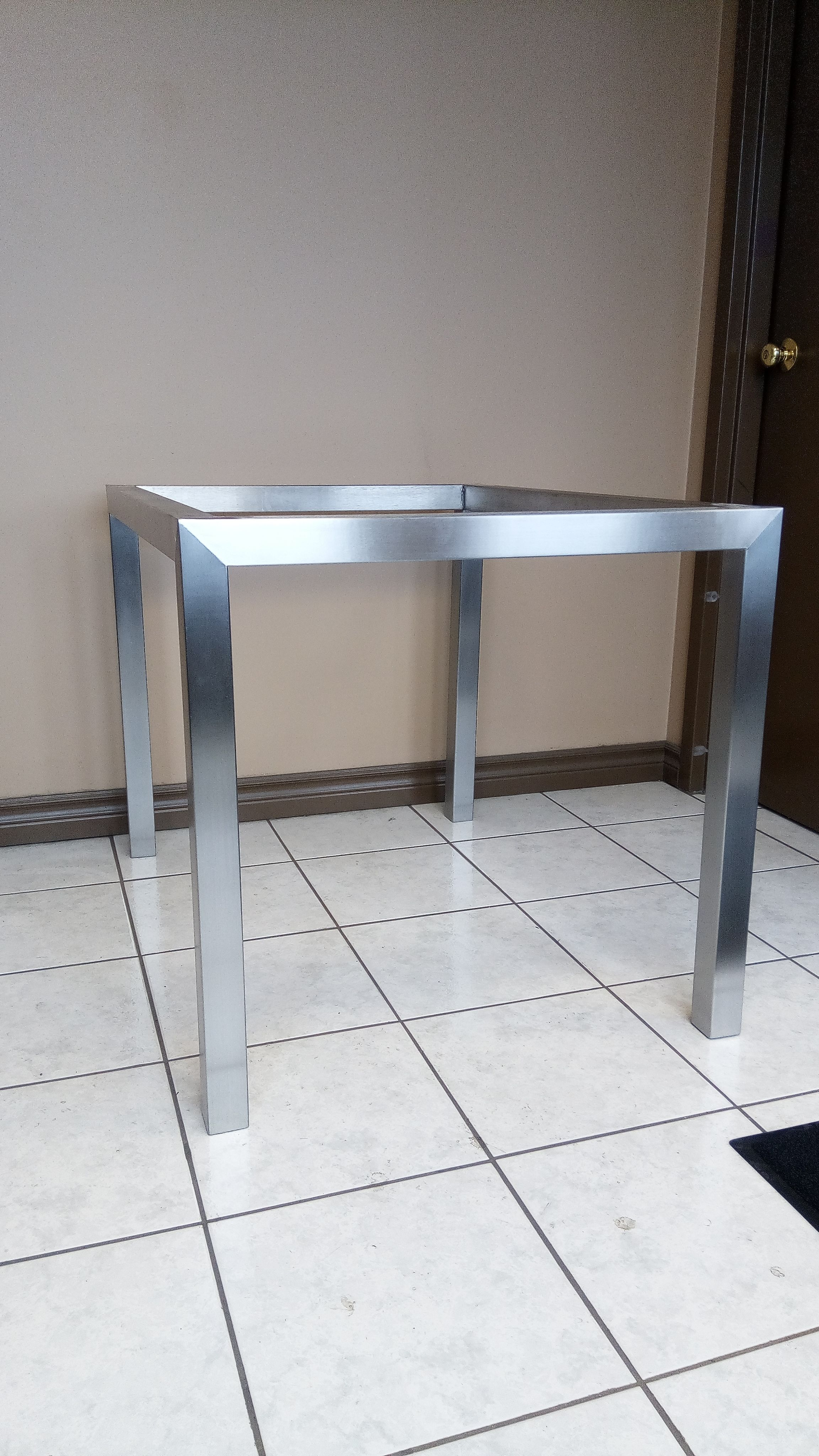 Custom stainless steel metal table frame Finished in a brushed