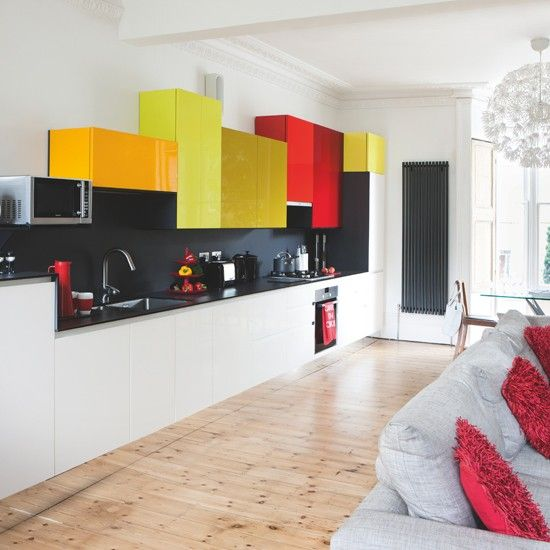 White Kitchen With Colourful Units The Coloured Cabinets