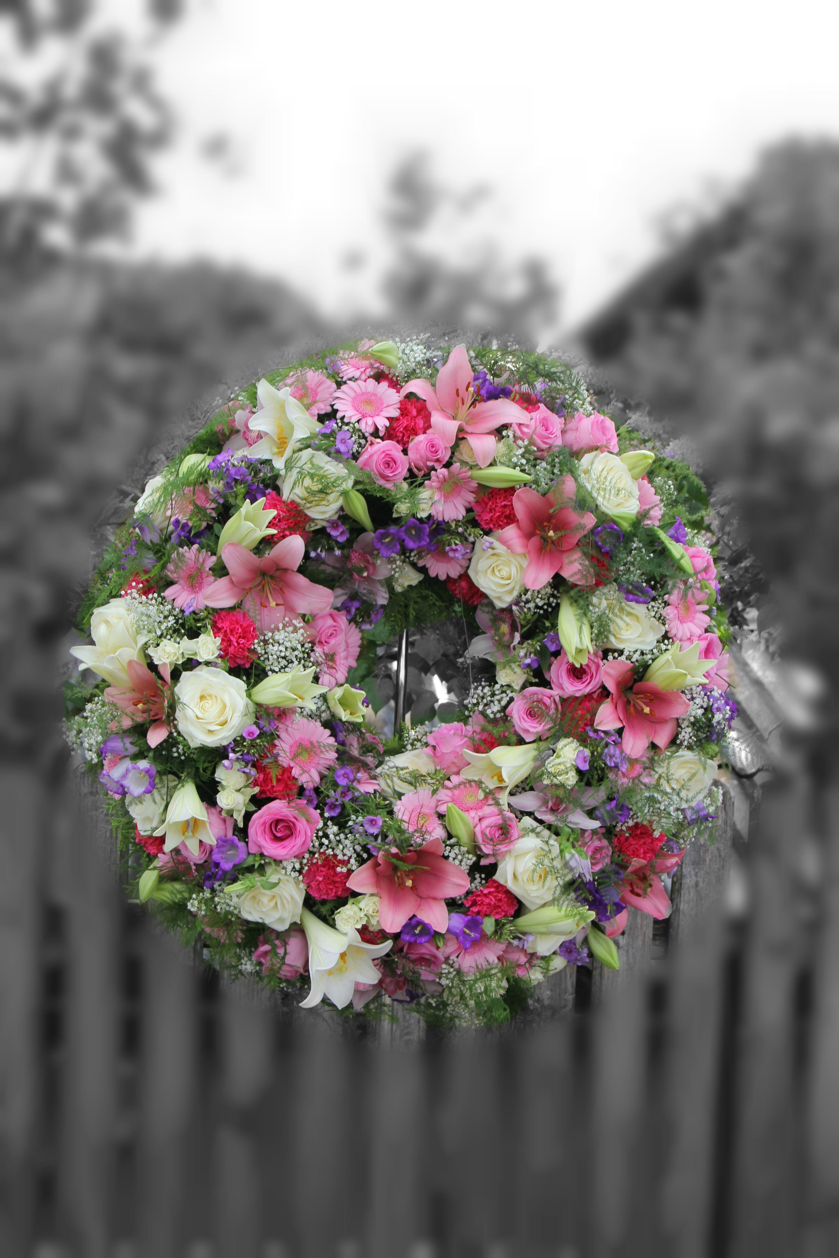 Photo of Funeral wreath in pink white with lilies, roses, germini and other loving flowers …