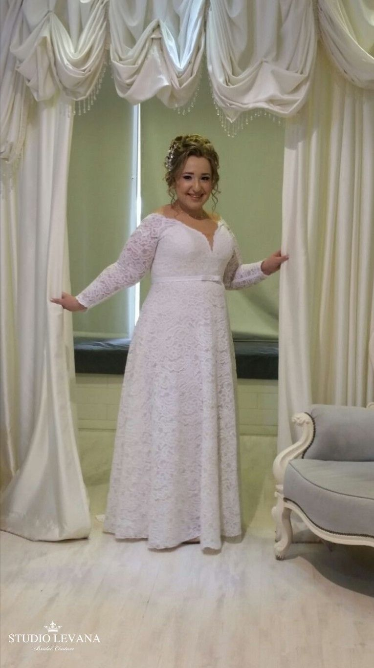 Plus size a line lace wedding gown with long sleeves on a real bride