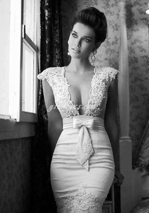 I never post anything from Pinterest, but I am obsessed with this wedding gown. Wedding gown with dramatic neckline