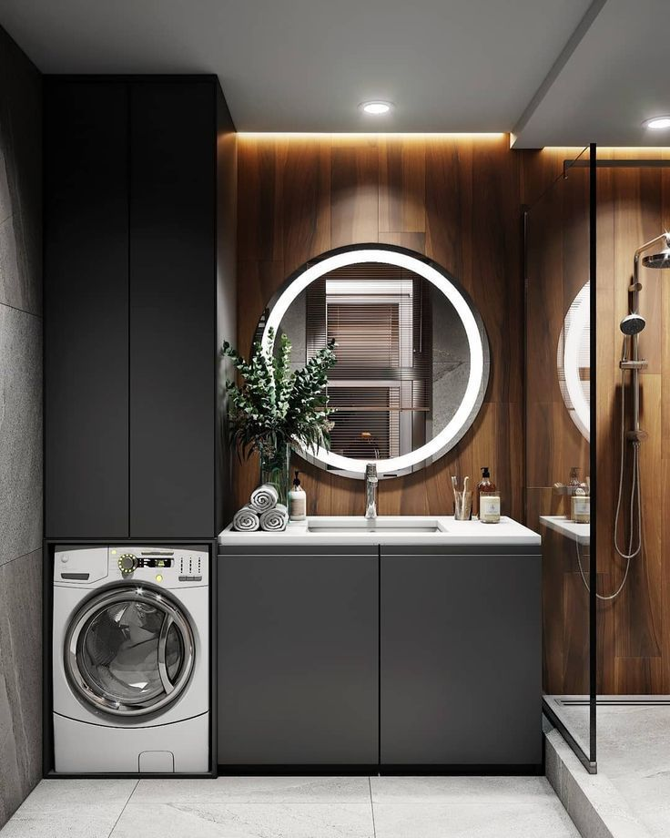 Photo of Built-in, integrated washing machine. Bathroom. Wood walls. Grey cabinets.