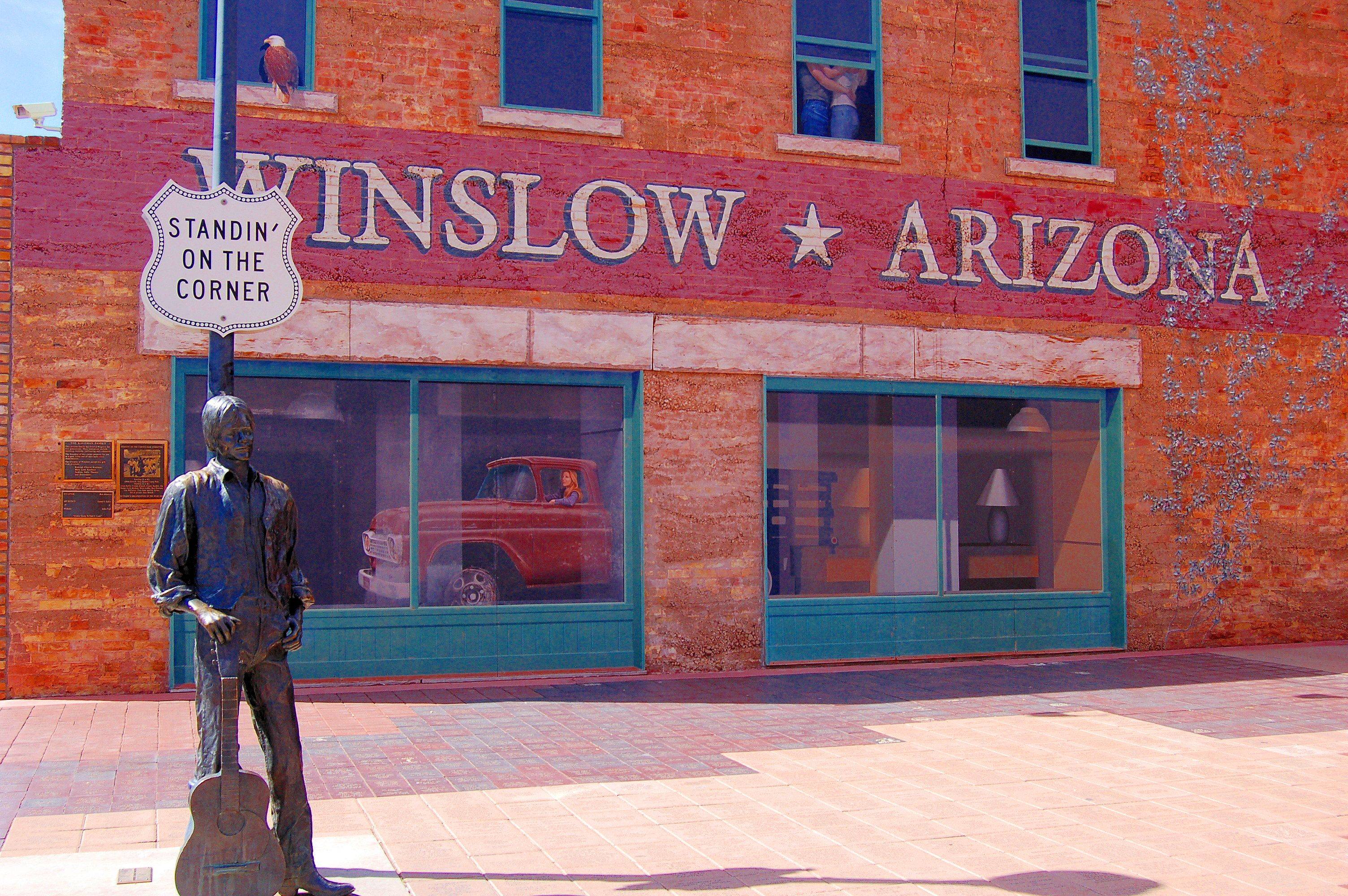 standing on a corner in winslow arizona such a fine sight to see it s a girl my lord in a flat bed ford slowin down to take a look at me