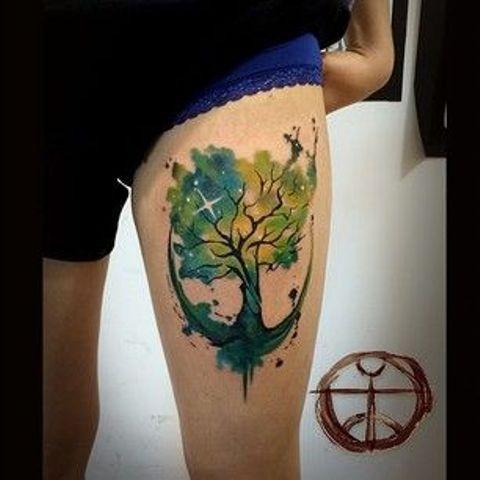Tree Watercolor Tattoo On Thigh Cosmic Tattoo Watercolor Tattoo