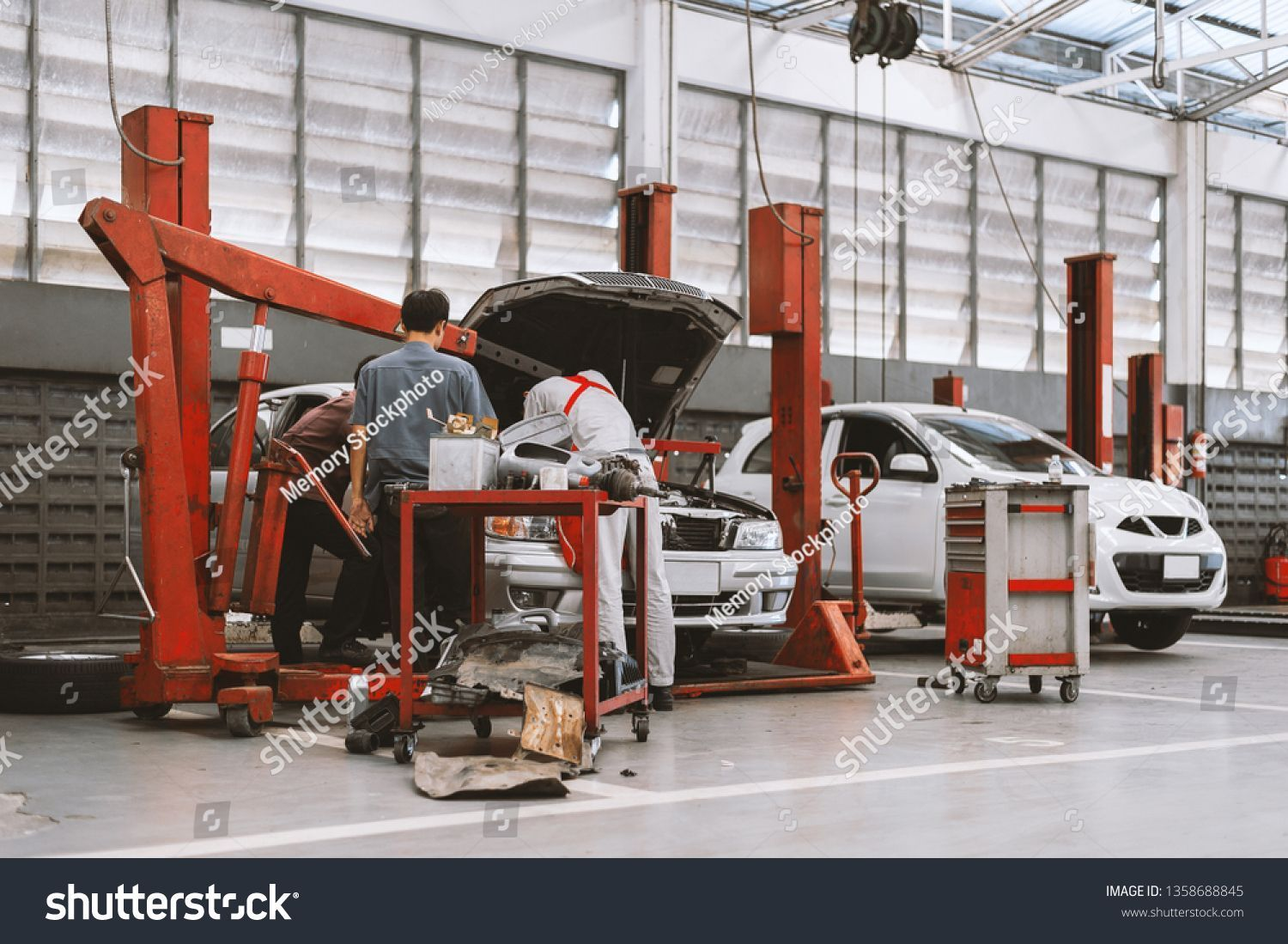 Interior Car Repair Garage Service Station Stock Photo Edit Now 1358688845 P Car Edit Garage In 2020 Car Repair Garages Car Repair Service Auto Service