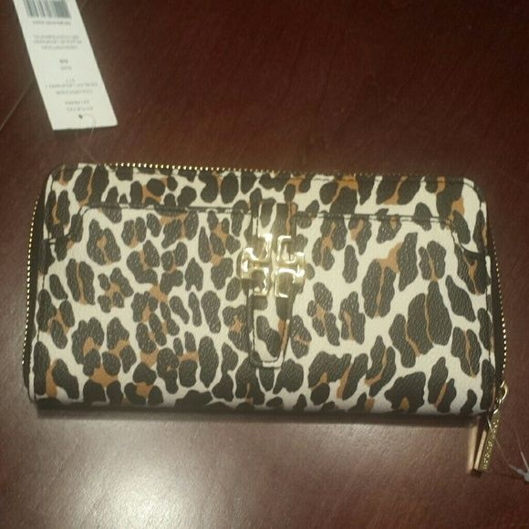 NWT Tory Burch Continental wallet New with tags, ocelot leopard wallet. 8 card slots, 2 money slots and front pocket with magnetic closure. Tory Burch Bags Wallets