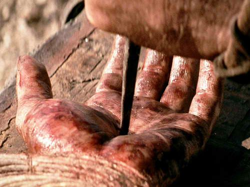 Image result for image of nails going into Jesus hands