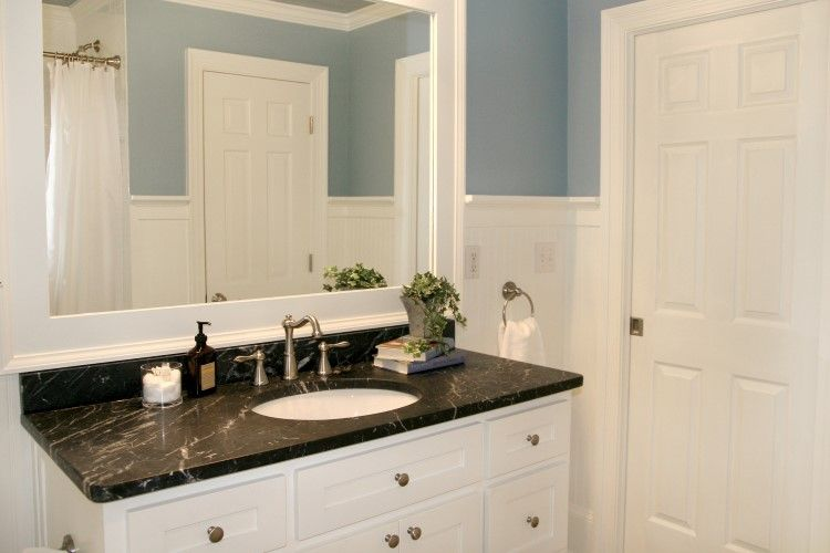 A Black Marble Countertop Anchors The Predominantly Blue And