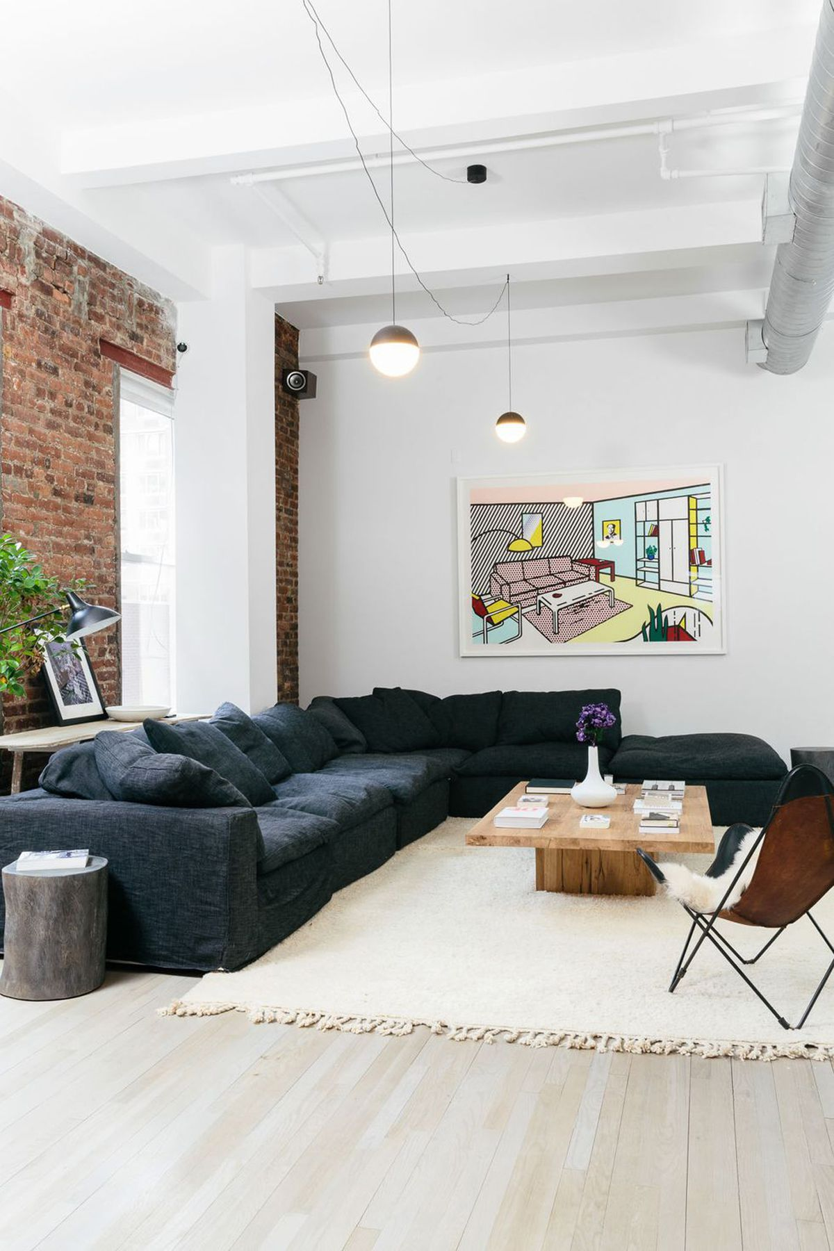 How Concrete Modernized A Former Celebrity Owned Condo In New York Living Room Loft Comfy Living Room Couches Living Room
