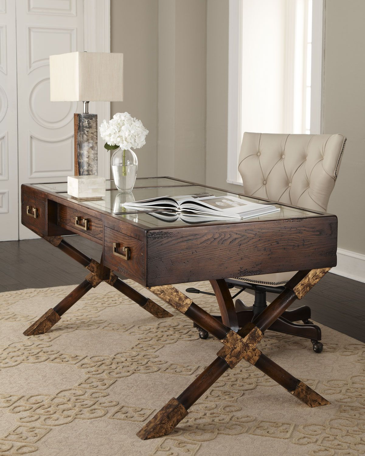 Sleek acacia wood paige desk from the john richard collection available at neiman marcus the 3 drawer desk is topped with antiqued eglomise glass with