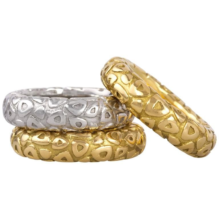 Chaumet Yellow and White Gold Stacking Rings | From a unique collection of vintage band rings at https://www.1stdibs.com/jewelry/rings/band-rings/