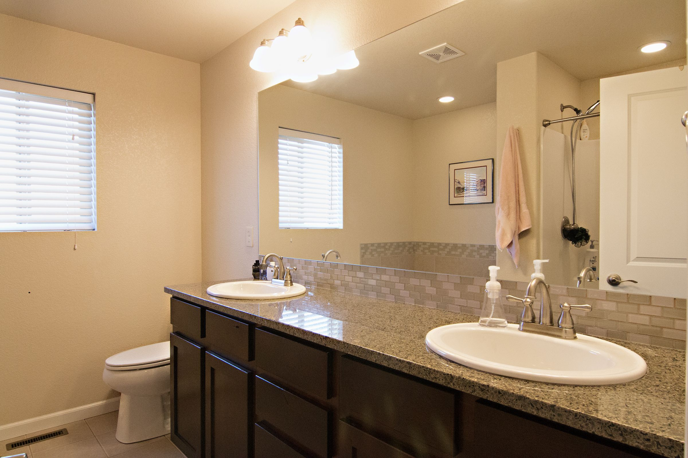 The 5 piece master bathroom at 2308 Big Lost Dr is beautifully upgraded with grey granite and a complimenting backsplash.What do you think? Call Kimber Parker at Team Properties Group for your showing today 307-670-2750
