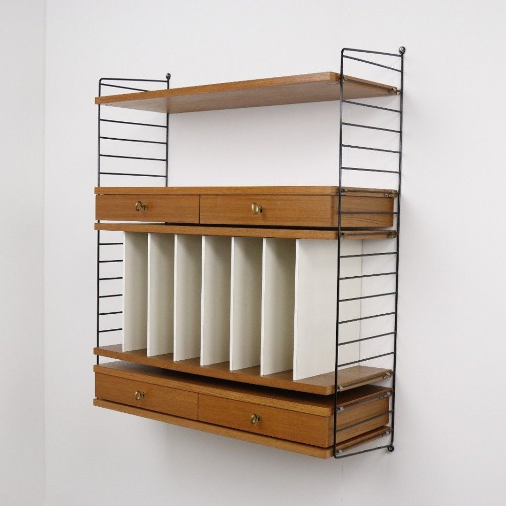 Nisse Strinning the ladder shelf wall unit from the fifties by nisse strinning for