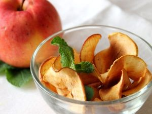 Apple chips. sliced thin the apple , dry in the oven 2 hour in 100 celsium degree with open door or in microwave 15 min 90 degree