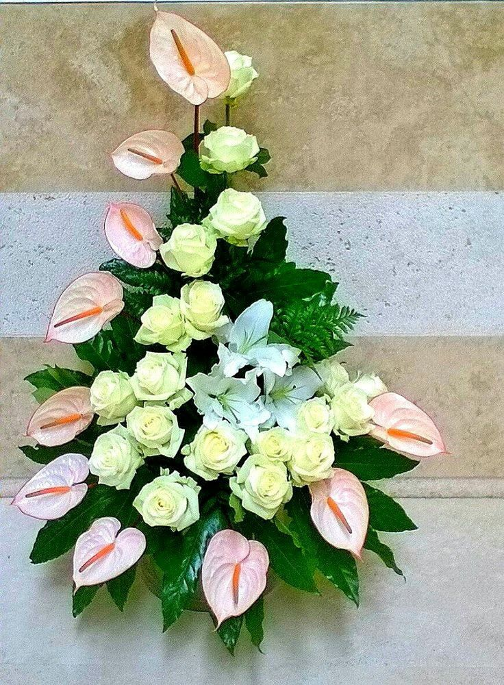 The Anthurium Flowers Are Placed On The Outside While The Roses Are On The Inside Tropical Flower Arrangements Flower Arrangements Large Flower Arrangements