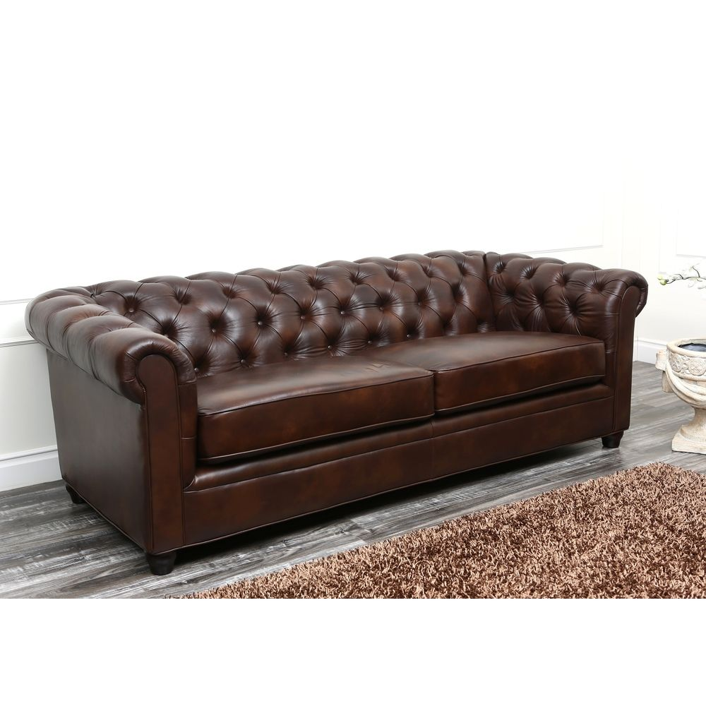leather office couch. complement all the wood and metal of an industrial space with a tufted leather sofa that office couch