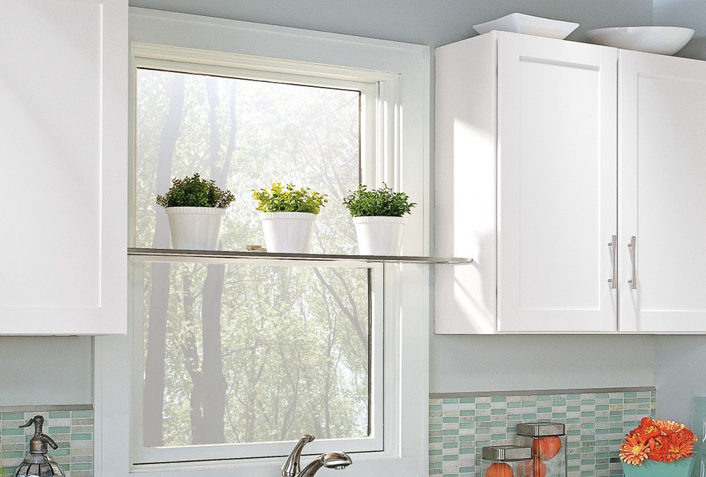 Bring The Outdoors Inside By Installing An Unobtrusive Glass Plant Shelf In Front Of A Window