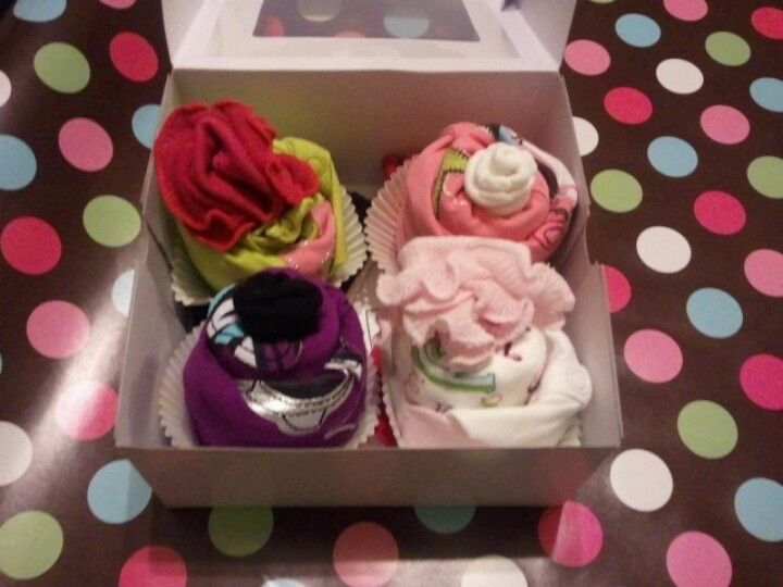 "The ""cupcakes""; these are made from onesies and socks. Did them for Mrs. Jessica Freeman's baby shower."