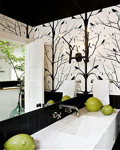 The branches painted onto the walls of this bathroom continue the motif that reoccurs throughout the house.