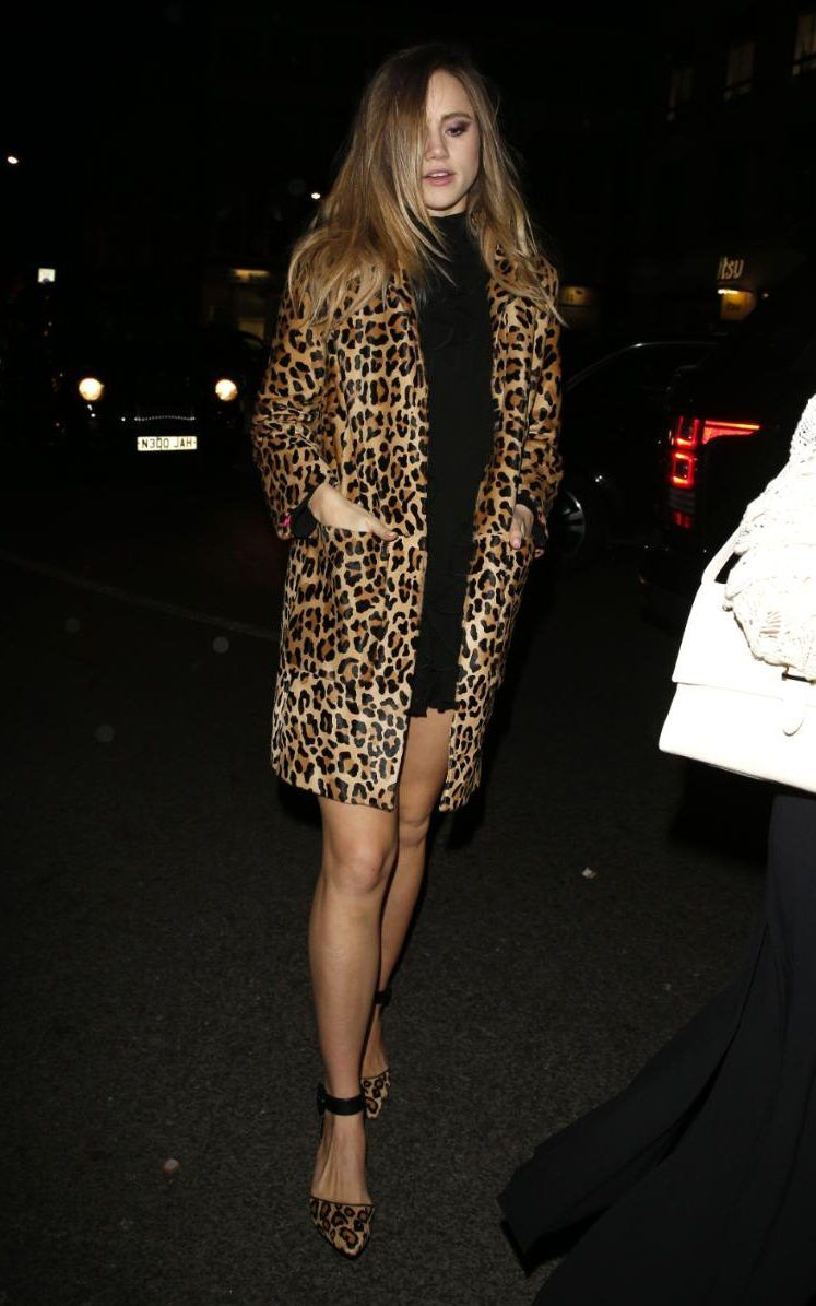 Yet she played up her sex kitten persona in a leopard print coat and ...